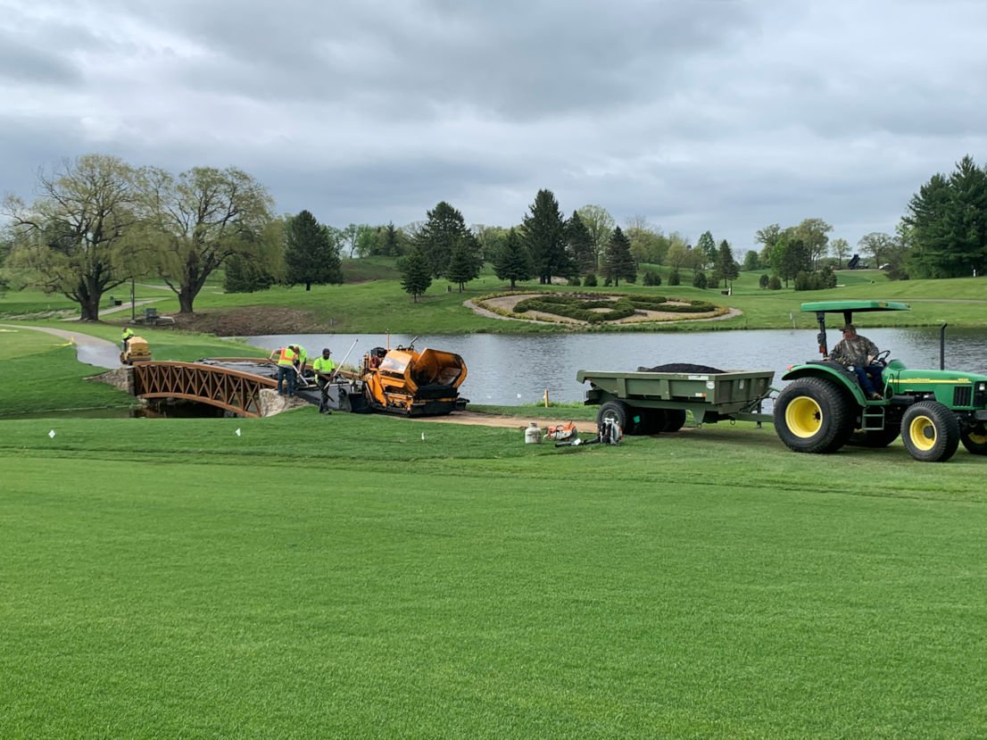 The large tires on Hartman Companies equipment 'float' across the grass to minimize impact of construction on the turf