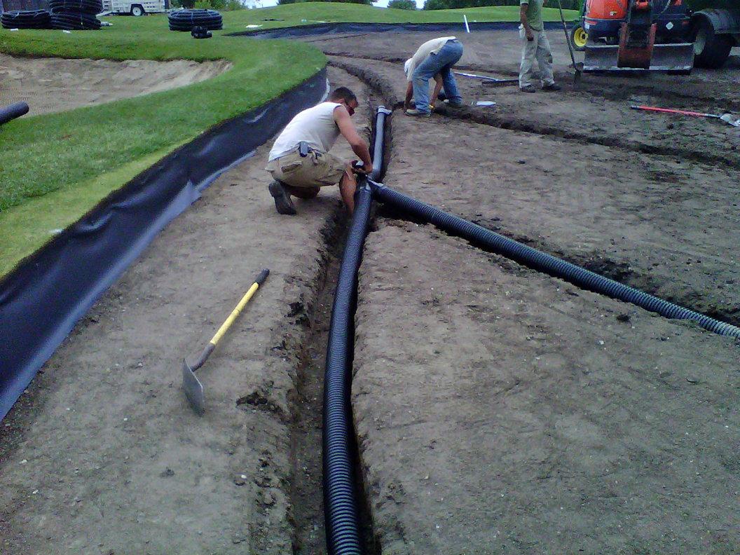 Installing drainage tile on Hazeltine National Golf Club