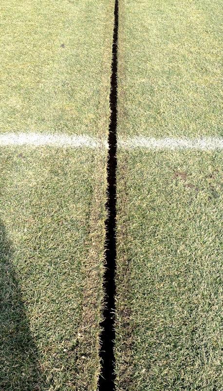 Mankato State football field slit drainage channels