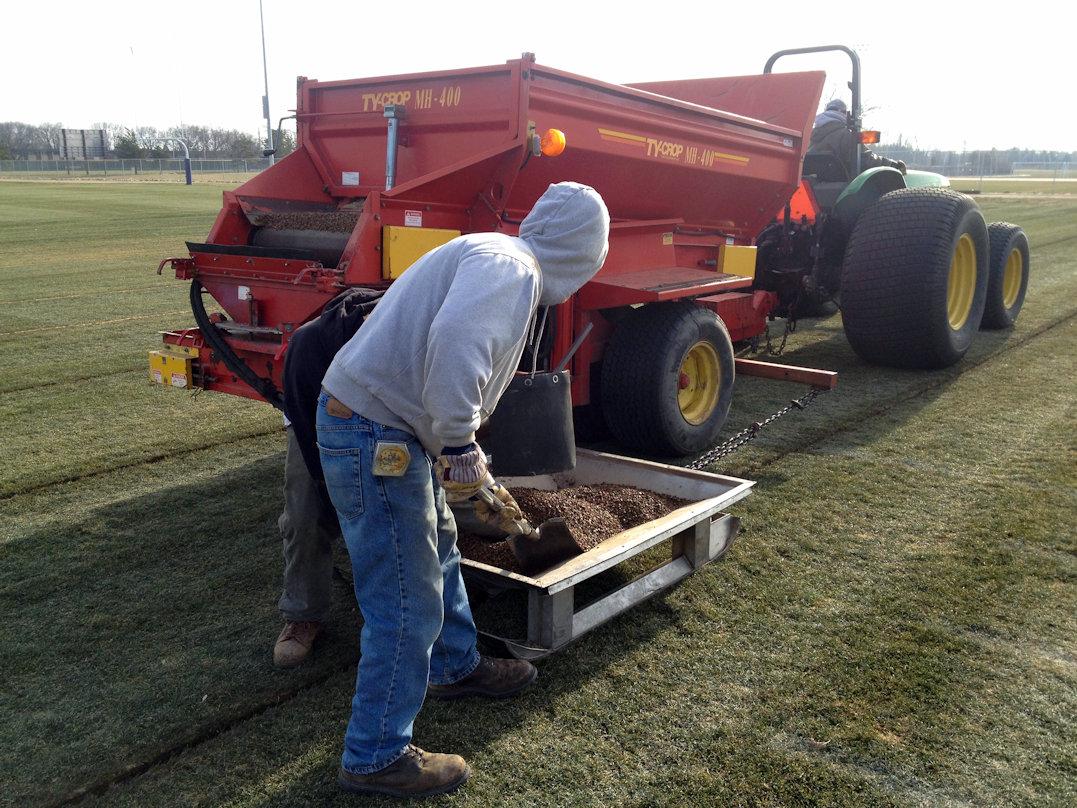 Mankato State football field slit drainage fill-in