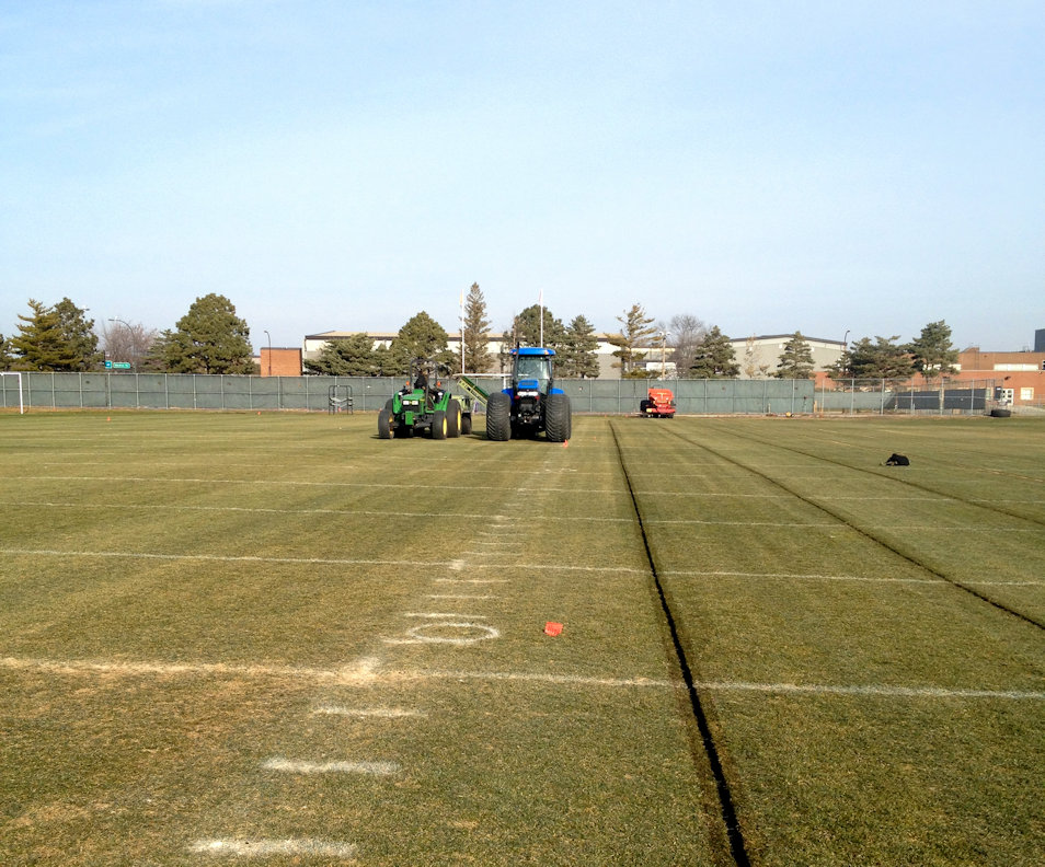 Cutting a slit trench with our Shelton Sportsturf drainage wheel trencher